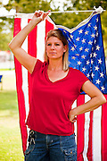 Nov. 11, 2009 -- PHOENIX, AZ: AMY TICE, from Glendale, AZ, holds up an American flag during a protest against the Obama administration in Phoenix Wednesday. About 200 people came to the Arizona State Capitol Lawn Wednesday, Nov 11 to hold protest against the administration of President Barack Obama and show support for US service people and veterans.   Photo by Jack Kurtz