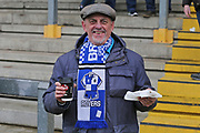 Bristol Rovers fan with food and drink getting ready for the EFL Sky Bet League 1 match between Bristol Rovers and Doncaster Rovers at the Memorial Stadium, Bristol, England on 23 December 2017. Photo by Gary Learmonth.