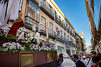 Seville's narrow streets are filled with locals and visitors as the statue of the Virgin Mary is carried through the streets during a religious festival in May.