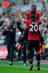 Man Utd Forward Robin van Persie (NED) celebrates with Man Utd Defender Patrice Evra (FRA) after scoring a goal during the second half of the match - Photo mandatory by-line: Rogan Thomson/JMP - Tel: Mobile: 07966 386802 17/08/2013 - SPORT - FOOTBALL - Liberty Stadium, Swansea -  Swansea City V Manchester United - Barclays Premier League - First round of the 2013/14 season and the first league match for new Man Utd manager David Moyes.
