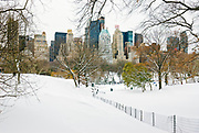 View of Central Park and the Midtown Manhattan Skyline, New York City during winter snowstorm.