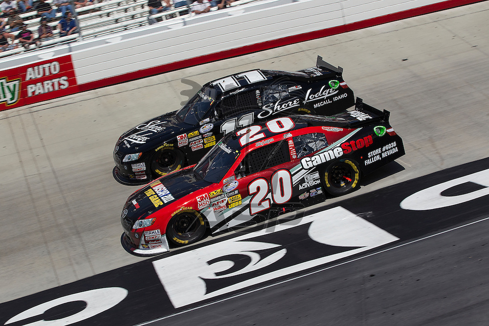 BRISTOL, TN - MAR 19, 2011:  Joey Logano (20) and Brian Scott (11) race for position during the Scotts EZ Seed 300 race at the Bristol Motor Speedway in Bristol, TN.