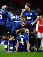 Picture by Andrew Tobin/Focus Images Ltd. 07710 761829. .21/01/12. Wayne Rooney (10) of Manchester United checks on Phil Jones (4) of Manchester United ho hurt his leg and was carried off during the Barclays Premier League match between Arsenal and Manchester United at Emirates Stadium, London.