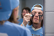 05/25/2014 - Baltimore, Md. - Kane Delaney, A14, applies eye black in the locker room before taking the field in Tufts' 12-9 win over Salisbury to win the NCAA Division III Men's Lacrosse National Championship game at M&T Bank Stadium on May 25, 2014. (Kelvin Ma/Tufts University)