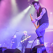REEVES GABRELS, ROBERT SMITH and SIMON GALLUP of The Cure performs at Merriweather Post Pavilion.  The band performed 32 songs in a career-spanning set.