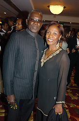 Actor RUDOLPH WALKER and his wife  at the 10th Anniversary Asian Business Awards 2006 at the London Grosvenor Hotel Park Lane, London on 19th April 2006.<br />
