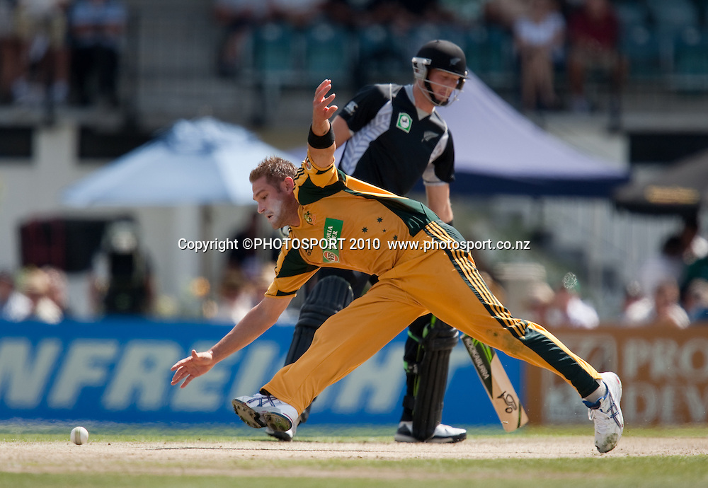 Ryan Harris fields from his own bowling during the third one day Chappell Hadlee cricket series match between New Zealand Black Caps and Australia at Seddon Park, Hamilton, New Zealand. Tuesday 9 March 2010. Photo: Stephen Barker/PHOTOSPORT