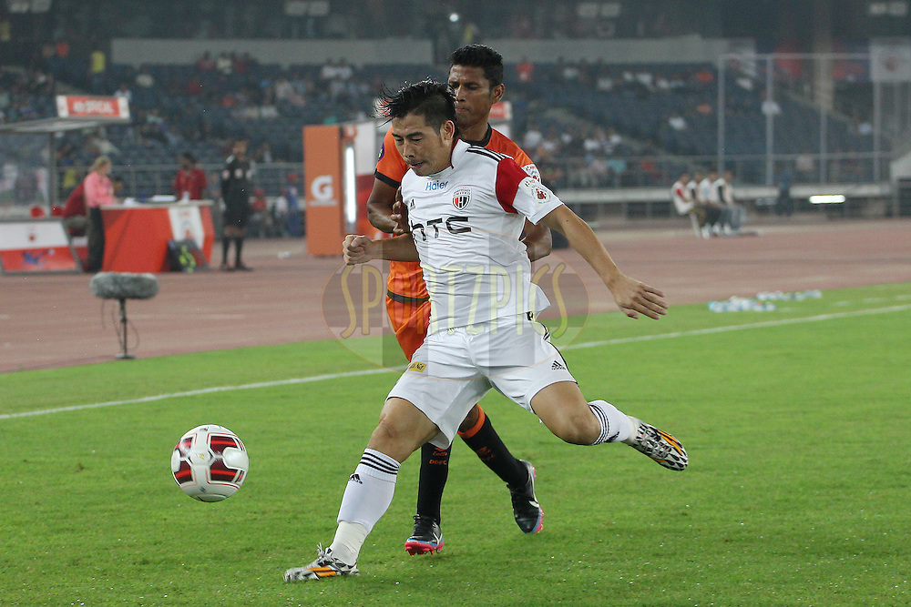 Robin Gurung of NorthEast United FC and Steven Dias of Delhi Dynamos FC battle for the ball during match 16 of the Hero Indian Super League between The Delhi Dynamos FC and NorthEast United FC held at the Jawaharlal Nehru Stadium, Delhi, India on the 29th October 2014.<br /> <br /> Photo by:  Ron Gaunt/ ISL/ SPORTZPICS