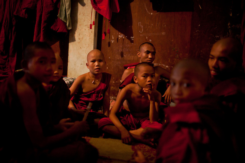 During their free time, a group of novice monks gather to socialize and relax before studies continue in the afternoon.