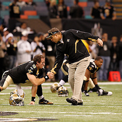 December 12, 2010; New Orleans, LA, USA; New Orleans Saints head coach Sean Payton talks with quarterback Drew Brees (9) during warm ups prior to kickoff of a game against the St. Louis Rams at the Louisiana Superdome. Mandatory Credit: Derick E. Hingle-US PRESSWIRE