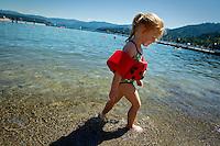 Chloe Hyder walks along Honeysuckle Beach Sunday, July 25, 2010 while visiting family in Hayden Lake, Idaho.