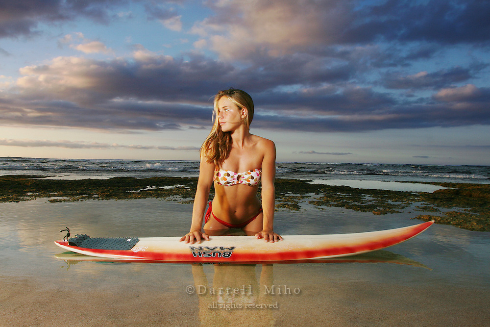 Nov. 06, 2006; Sunset Beach, HI, USA;  Jill Wenderlich poses with her surfboard on the North Shore of Oahu, Hawaii...Photo credit: Darrell Miho.