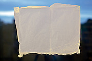 semi transparent paper blocking view towards rural countryside landscape at sunset sunrise