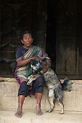 Chang Naga woman & dog<br /> Chang Naga headhunting Tribe<br /> Tuensang district<br /> Nagaland,  ne India
