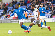 Macclesfield Town forward Arthur Gnahoua tackled by the opponent during the EFL Sky Bet League 2 match between Macclesfield Town and Colchester United at Moss Rose, Macclesfield, United Kingdom on 28 September 2019.