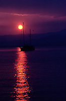 Sail Boat at sunset, St. Tropez Bay, France   Photo: Peter Llewellyn