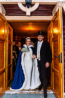 Bride and groom leaving the church after their wedding ceremony at Plassen Church (kirke), a wooden (stave) church originally built in 1879. It burnt to the ground in 1904 and was rebuilt in 1907. Trysil, Norway.