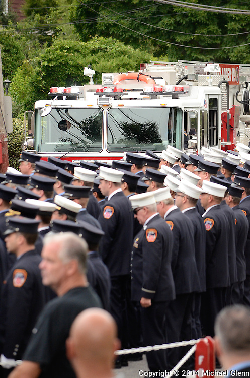 Staten Island, New York - July 10: 1000s of Firefighters line the street at the Funeral of Lt Gordon M. Ambelas L119 at Saint Clares Church on July 10, 2014 in New York, New York. Photo Credit: Michael Glenn / Glenn Images