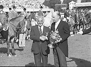Dublin Horse Show (Aga Khan Cup).1986..08.08.1986..08.08.1986..8th August 1986..The annual Aga Khan Cup competition was held in the R.D.S. Dublin.Four countries competed for the cup this year.FDR Germany,The USA,Great Britain and Ireland. Great Britain were the eventual winners...Pictured making the presentation of The Aga Khan cup are President of Ireland,Dr Patrick Hillery and on behalf of the Great Britain team, Mr Ronnie Massarella, Chef d'Equipe.