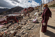 For a story by Ed Wong : CHINASICHUAN - Two journals in Sichuan<br /> Larung Gar, Sertar, Sichuan, China<br /> October 8th, 2016<br /> A Buddhist monk staring at the ruins of dismantled cells. Thousands of monks and nuns from Tibetan regions and the rest of China, live and study in Larung Gar an influential Buddhist academy. Chinese authorities have requested that the number be reduced by 5000. The dismantling of cells where nuns and monks live, has begun.