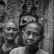 Scenes from Angkor Wat of Buddhist monks, Nuns and temple girls.
