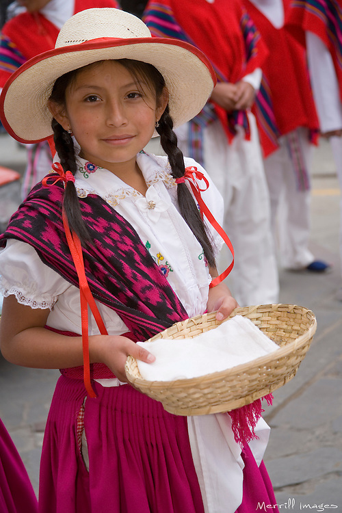 South America, Ecuador, Cuenca.  Girl dancer in folklore troupe during annual parade and festival to celebrate founding of Cuenca in 1557.  Cuenca is a UNESCO World Heritage Site.  NMR