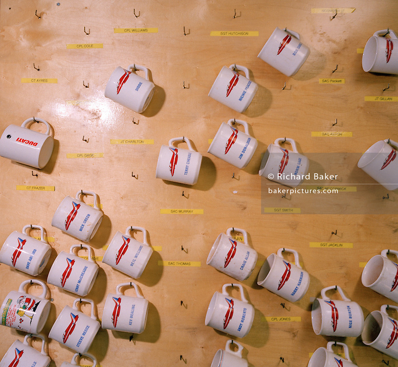Engineering ground staff's tea mugs of the Red Arrows, Britain's RAF aerobatic team.