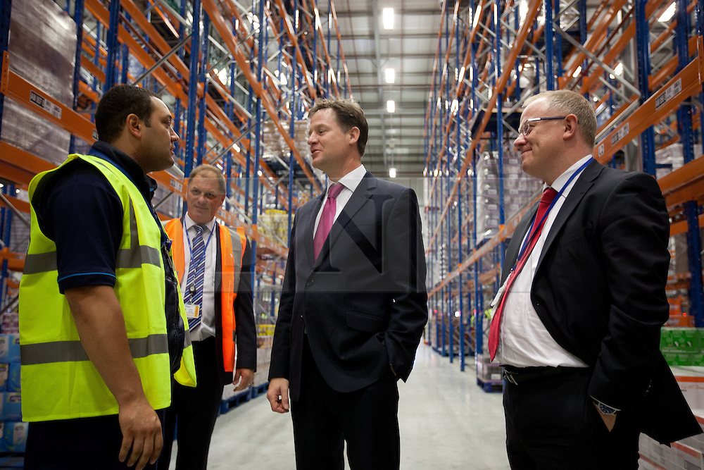 © Licensed to London News Pictures. 25/06/2013. London, UK. British Deputy Prime Minister, Nick Clegg (centre) and Sainsbury's chief financial officer, John Rogers (right), talk to an employee of the supermarket during the opening of the chain's new state of the art logistics centre in Charlton, London, today (25/06/2013). The logistics centre, currently responsible for supplying around 90 supermarkets in the South East, has so far created 60 jobs on site, with another 1000 to follow in the next three years. Photo credit: Matt Cetti-Roberts/LNP