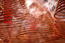 Burning incense coils in Man Mo Temple in Hong Kong