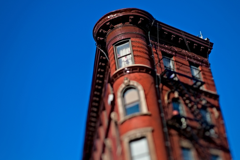 Old brick apartment building against blue sky