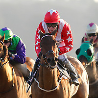 Rich Again and J P Spencer winning the 2.00 race