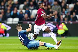 Michail Antonio of West Ham United is tackled by Juan Foyth of Tottenham Hotspur - Mandatory by-line: Robbie Stephenson/JMP - 31/10/2018 - FOOTBALL - London Stadium - London, England - West Ham United v Tottenham Hotspur - Carabao Cup