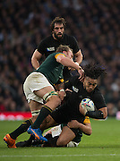 Twickenham. Great Britain,  behind, Francois LOUW and Schalk BURGER tackle NZL's Ma'a NONU, during, Semi Final 1. South Africa vs New Zealand  2015 Rugby World Cup,  Venue, Twickenham Stadium, Surrey England.   Saturday  24/10/2015.   [Mandatory Credit; Peter Spurrier/Intersport-images]