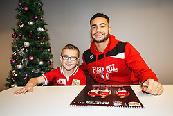 Derrick Williams of Bristol City poses with a young fan as Season ticket holders and members of Bristol Sport 7s and Forever Bristol take part in a Bristol Sport Christmas Party - Mandatory byline: Rogan Thomson/JMP - 22/12/2015 - SPORT - Ashton Gate Stadium - Bristol, England - Bristol Sport Christmas at Ashton Gate.