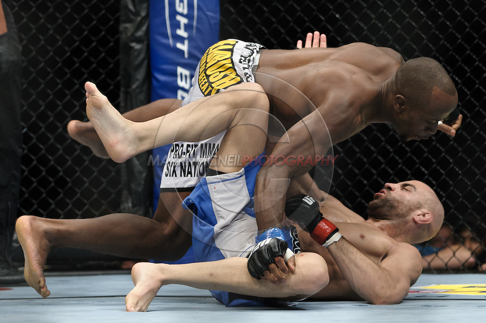 """LONDON, ENGLAND, OCTOBER 2010: Claude Patrick (top) launches himself through the guard of James Wilks during """"UFC 120: Bisping vs. Akiyama"""" inside the O2 Arena in Greenwich, London"""