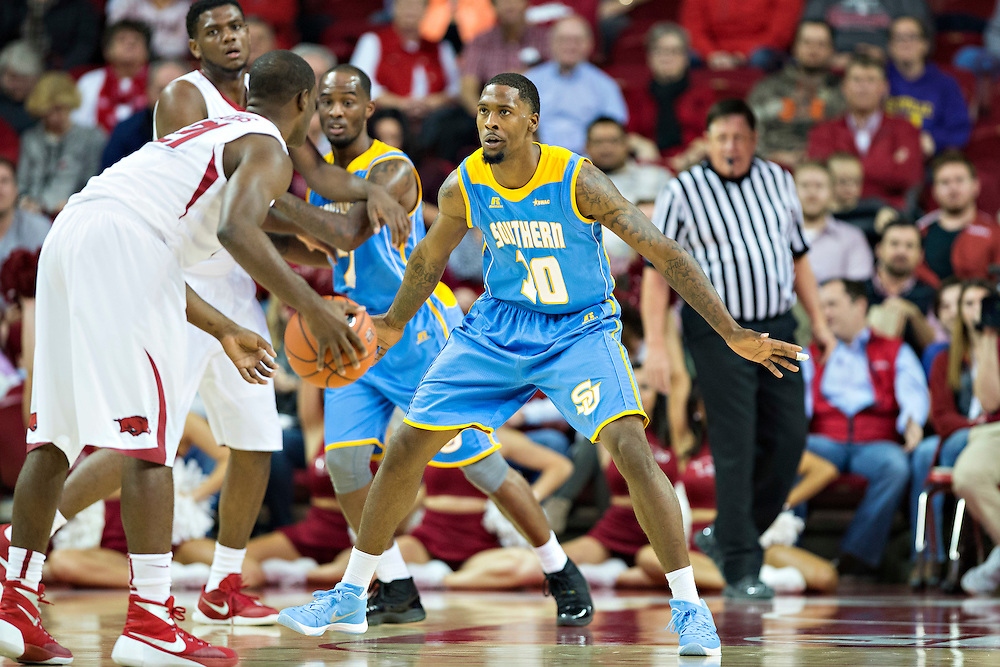 FAYETTEVILLE, AR - NOVEMBER 13:  Shawn Prudhomme #10 of the Southern University Jaguars plays defense against Manuale Watkins #21 of the Arkansas Razorbacks at Bud Walton Arena on November 13, 2015 in Fayetteville, Arkansas.  The Razorbacks defeated the Jaguars 86-68.  (Photo by Wesley Hitt/Getty Images) *** Local Caption *** Shawn Prudhomme; Manuale Watkins