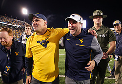 Nov 4, 2017; Morgantown, WV, USA; West Virginia Mountaineers head coach Dana Holgorsen celebrates with West Virginia Mountaineers defensive coordinator Tony Gibson celebrate after beating the Iowa State Cyclones at Milan Puskar Stadium. Mandatory Credit: Ben Queen-USA TODAY Sports