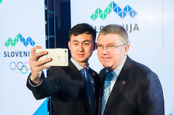 Member of PEAK Sports with Thomas Bach, IOC  International Olympic Committee president  during official presentation of the Designer wear for Slovenian Athletes at Rio Summer Olympic Games 2016, on April 15, 2016 in Hotel Lev, Ljubljana, Slovenia. Photo by Vid Ponikvar / Sportida