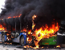 61139411<br /> Photo taken with a mobile phone on Feb. 27, 2014 shows the bus fire scene in Guiyang, capital of southwest China s Guizhou Province. A bus bursted into flames on Jinyang South Road in Guiyang on Thursday, leaving five people dead so far, Thursday, 27th February 2014. Picture by  imago / i-Images<br /> UK ONLY