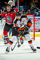 KELOWNA, BC - NOVEMBER 8:  Tyler Preziuso #22 of the Medicine Hat Tigers tries to connect with the puck against the Kelowna Rockets at Prospera Place on November 8, 2019 in Kelowna, Canada. (Photo by Marissa Baecker/Shoot the Breeze)