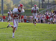 Cedar Rapids Washington's Clayton Bjornsen (7) scores on a 30 yard touchdown reception during their game at Xavier High School in Cedar Rapids on Friday, October 4, 2013. Washington defeated Xavier 26-10.