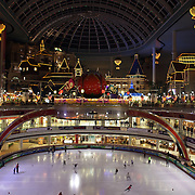 The interior of Lotte World at night time showing the ice rink and glass domed roof.  Lotte World is the world's largest indoor theme park which includes shopping malls, a luxury hotel, and an Ice rink. Opened on July 12, 1989, Lotte World receives over 8 million visitors each year. Seoul, South Korea. 21st March 2012. Photo Tim Clayton