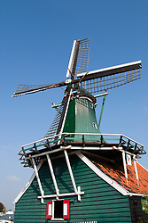 Windmills and historical outdoor museum area at Zaanse Schans, a popular day trip from Amsterdam.