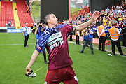 Burnley defender, Michael Duff (04) throwing boot into crowd during the Sky Bet Championship match between Charlton Athletic and Burnley at The Valley, London, England on 7 May 2016. Photo by Matthew Redman.