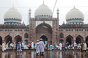 During the holy month of Ramadan, two Muslim boys are walking under the rain inside the Taj-ul-Masajid, one of Asia's largest mosques, in Bhopal, Madhya Pradesh, India.