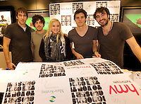 HMV welcomed The Coronas to HMV Galway  for a live performance and to sign copies of their highly anticipated third album Closer To You and metValerie Friel, Newcastle, Galway who managed to get one of the HMV /Coronas giant poster signed for herself . Photo:Andrew Downes.