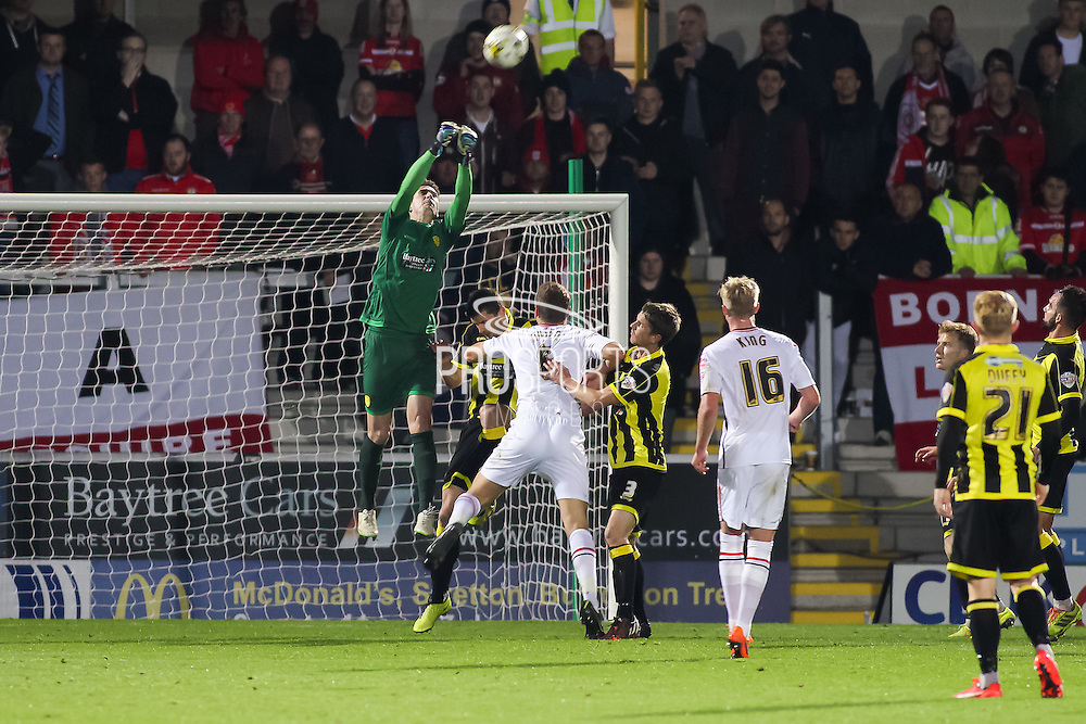 Burton Albion goalkeeper Jon McLaughlin makes a save in the air during the Sky Bet League 1 match between Burton Albion and Crewe Alexandra at the Pirelli Stadium, Burton upon Trent, England on 20 October 2015. Photo by Aaron Lupton.