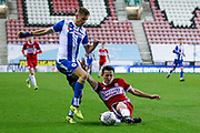 Middlesbrough defender Patrick Reading (53) with a sliding tackle during the EFL Trophy match between Wigan Athletic and U21 Middlesbrough at the DW Stadium, Wigan, England on 24 October 2017. Photo by Simon Davies.