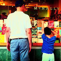 Father and son looking at books through a shop window. Greenwich Village, Manhattan, New York City