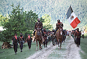 Zapatista sub commander Marcos leads a parade of guerilla soldiers at his stronghold of La Realidad in the jungles of Chiapas, Mexico shortly after the Zapatista uprising of New Year's Day, 1994. Holding the Mexican flag is commander Tacho.
